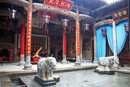 chinese courtyard: Courtyard of historical chinese house in anhui province decorated with horse statues in the rain