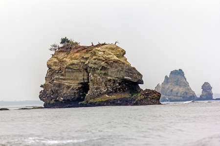 protruding: rockc protruding from the misty sea at matsushima, Japan