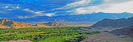 indian village: panoramic photo of Leh, the capital of Ladakh, India seen from the hilll with mountains in background,  stylized and filtered to resemble an oil painting