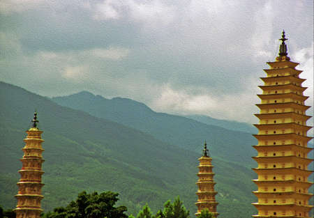 dali: Photo of three famous pagodas in Dali, Yunnan Province, China,  stylized and filtered to resemble an oil painting
