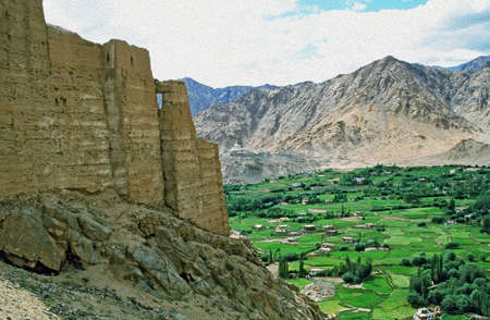 Suburbs of Leh, the capital of Ladakh seen from the hilll with ruins of Leh palace in foreground and mountains in background,  stylized and filtered to resemble an oil painting