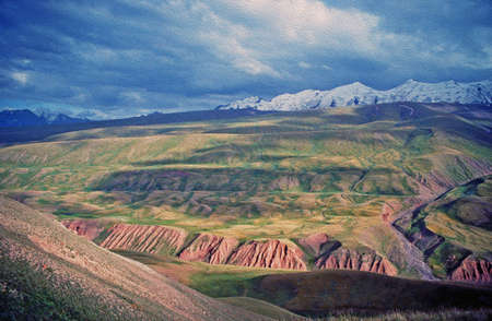 vistas: asian landscape of Alay valley, Kyrgyzstan, large vistas of space - steppe and Pamir mountains,  stylized and filtered to resemble an oil painting Stock Photo