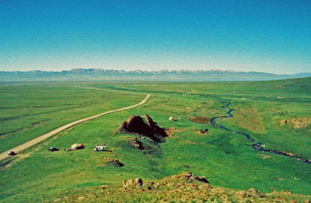 vistas: large vistas of asian steppe in Kyrgyzstan with small silhouettes of grazing horses and a lake and Tien Shan mountains in background,  stylized and filtered to resemble an oil painting