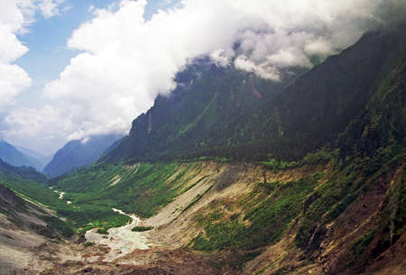 vintage style photo of glacier valley surrounded by mountains in hailougou glacier national park, sichuan province, china, stylized and filtered to look like an oil painting