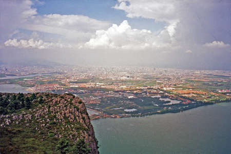vintage style photo of aerial view of Kunming, Yunnan, China, and dian lake seen from longmen mountains