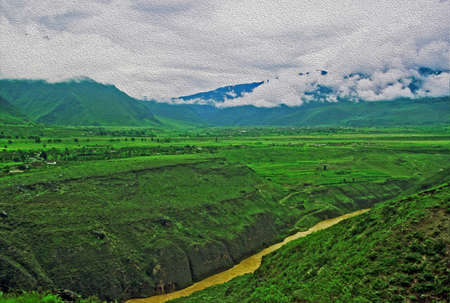 chinese landscape in yunnan province - deep river canyou, lush green fields and mountains enshrouded with mist,  stylized and filtered to resemble an oil painting Reklamní fotografie