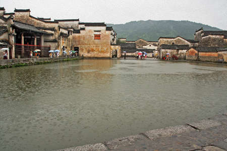 The famous moon pond in ancient Hongcun village, china,  stylized and filtered to resemble an oil painting