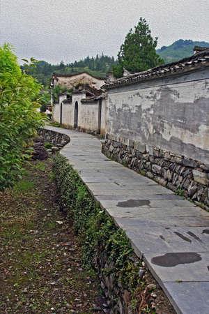 安徽省, 中国の, 垂直、西逓村古代の村の壁のまわりの石経路様式し、油絵のようにフィルタ リング 写真素材
