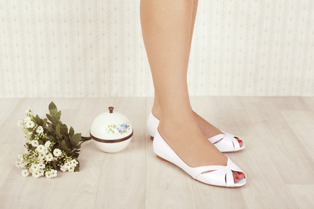 white shoes and white flowers