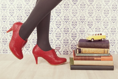 red shoes and and old books  Stock Photo