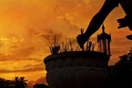 Incense on sunset background