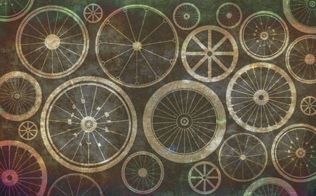 Vintage brown background with bicycle wheels