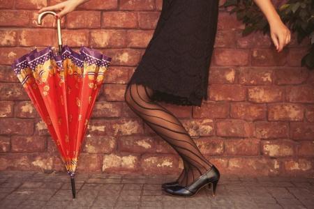 Fashionable woman holding an umbrella