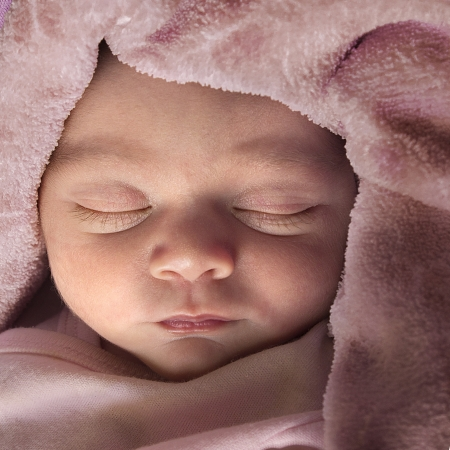 Baby face in a good and peaceful sleep in a square format composition Stock Photo