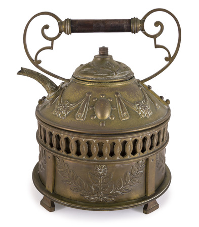 Old teapot made of bronze on white background isolated including path Stock Photo