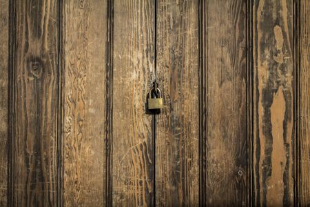 wood panels background with lock in the
