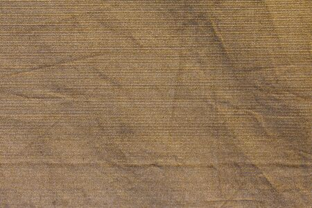 Brown fabric net background with folds in rough texture