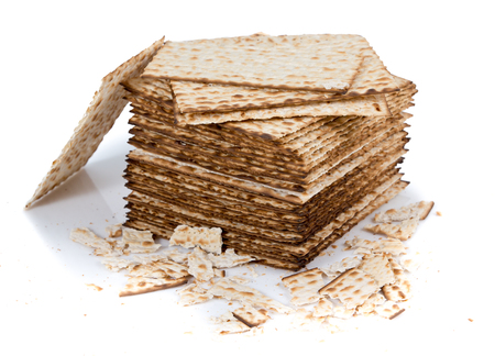 Pile of matza and some broken matza at the side - Traditional kosher bread for Passover Stock Photo