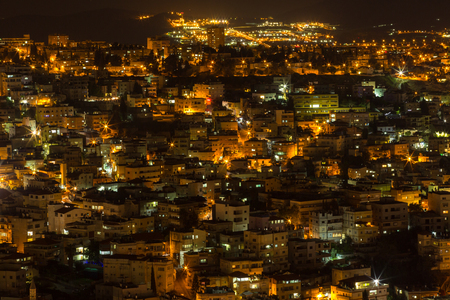 Top view of the old city lights and buildings - Nazareth in the night - Located in the north of Israel Stock Photo