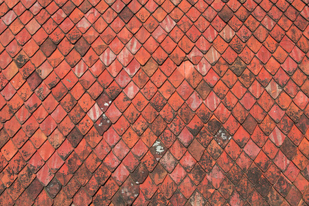 Red roofing tiles texture an old roof background stock photo
