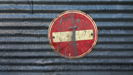 No entry traffic sign on metal board dirty and scratched – grunge style Stock Photo