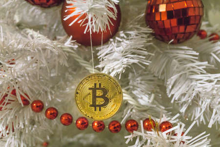 Bitcoin and christmas, new year gold bitcoin. Cryptocurrency bitcoin on a Christmas tree 写真素材