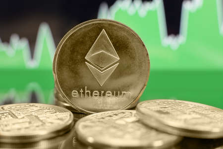 Ethereum ETH cryptocurrency coin on the green chart background. Bubble or bull trend concept. Banco de Imagens