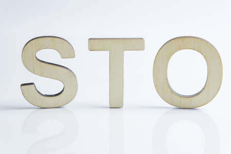 Security Token Offering STO sign with wooden letters, Ethereum concept on white background 写真素材