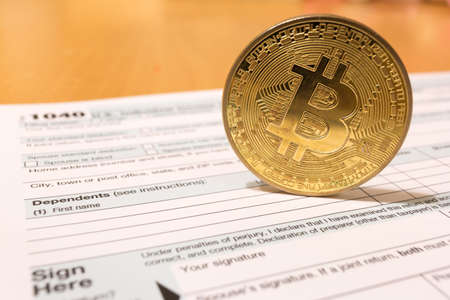 Bitcoin coin with 1040 income tax form for 2018 for filing on April 15