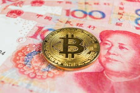 Crypto currency concept - A Bitcoin with Chinece currency RMB, Renminbi, yuan