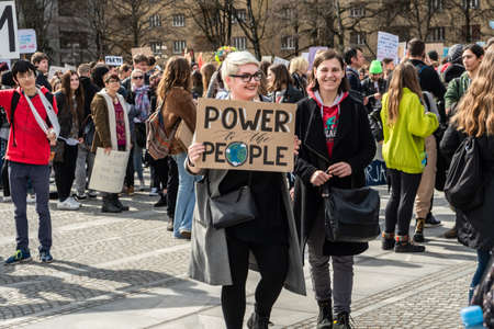 Slovenia, Ljubljana 15.03.2019 - Young protestors with banners at a Youth strike for climate march Editorial