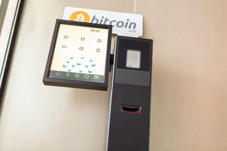 Bitcoin ATM machine in a business building for buying cryptocurrency and other altcoins Stock Photo