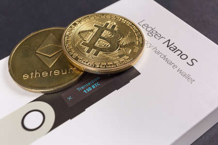 SLOVENIA - DECEMBER 27, 2018: Ledger hardware wallet for cryptocurrency like bitcoin, ethereum and others Sajtókép