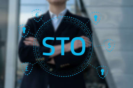 Security Token Offering STO cryptocurrency and blockchain concept, businessman pressing virtual graphics on virtual screens Фото со стока