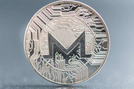 XMR. Monero Crypto currency silver coin, Macro shot of Iota coin isolated on background, cut out Blockchain technology, Stock fotó