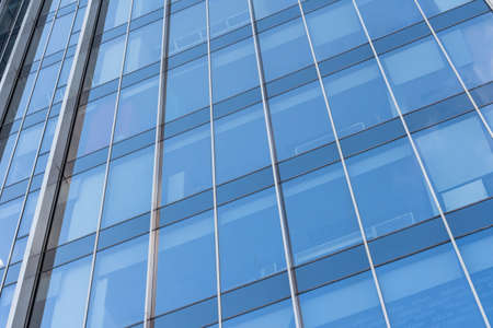 closeup of a modern window glass building reflecting Stock Photo - 124690047