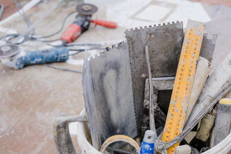 Differend kinds of all tiler tools in a bucket
