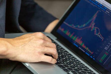 Stock Trader Looking At Stock Chart on Screen Фото со стока - 131326933