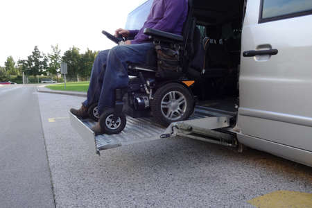 Disabled Men on Wheelchair using Accessible Vehicle with Lift Imagens