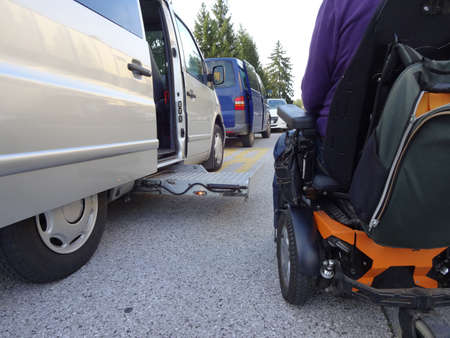 Disabled Men on Wheelchair using Accessible Vehicle with Lift Zdjęcie Seryjne