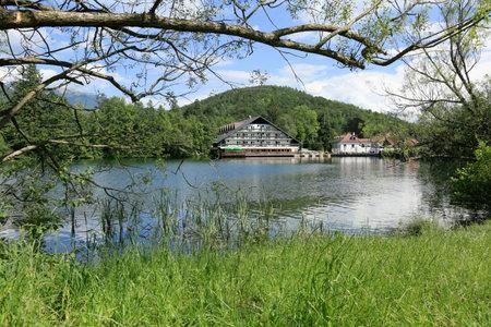 Breathtaking view of lake Crnava and Karavanke mountains in Preddvor, Slovenia. Reklamní fotografie - 136918865