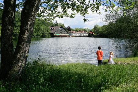 Slovenia, Preddvor - June 2 2019: Breathtaking view of lake Crnava and Karavanke mountains Reklamní fotografie - 136918866