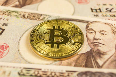cryptocurrency gold Bitcoin coin on Japanese yen Reklamní fotografie - 136866107