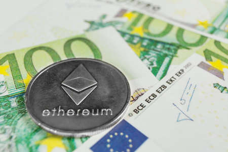 Crypto currency concept - A Ethereum with euro bills Reklamní fotografie - 136866113