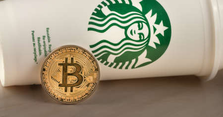Slovenia, Ljubljana - November 11, 2019: 4k resolution of Cryptocurrency Bitcoin on Starbucks cup Reklamní fotografie - 136926419