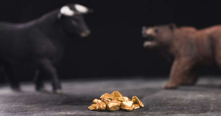 Gold market bearish or bullish trend with bull and bear figures in background Reklamní fotografie - 137882507
