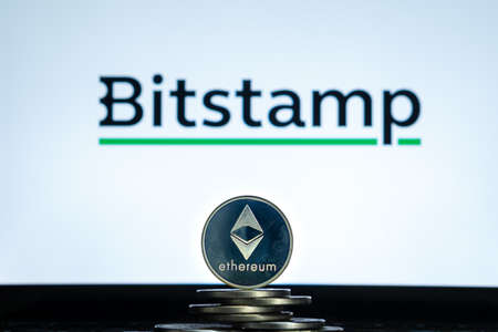 Ethereum coins with Bitstamp logo on a laptop screen. Slovenia, Ljubljana - 02 24 2019