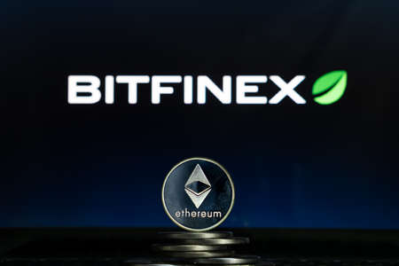 Ethereum coins with Bitfinex logo on a laptop screen. Slovenia, Ljubljana - 02 24 2019