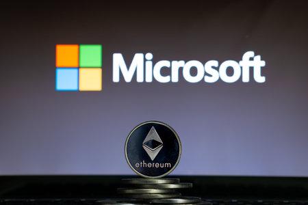 Ethereum coins with Microsoft logo on a laptop screen. Slovenia, Ljubljana - 02 24 2019 Reklamní fotografie - 136926552