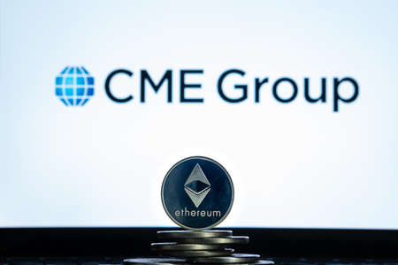 Ethereum coins with CME Group logo on a laptop screen. Slovenia, Ljubljana - 02 24 2019